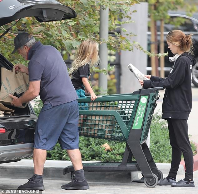 Back in black: Rosalind rocked a black hoodie and matching pants while Lars wore a black T-shirt and teal shorts. Gibson was out after having been hospitalized for COVID-19 in April