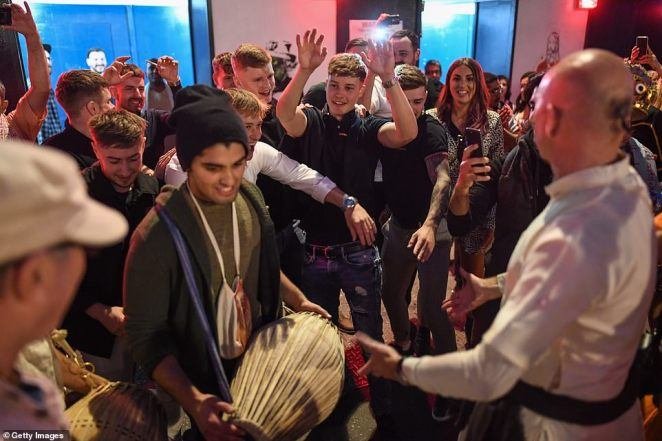 LONDON: Musicians with drums were also seen playing to crowds of people in the streets of Soho on the country's last night of freedom