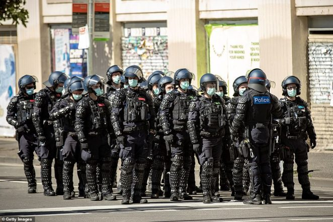 Protesters have clashed with police during a 'freedom walk' on Sunday to protest Victoria's strict lockdown