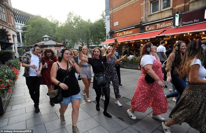 LONDON: A group of people wearing tour headphones and some with cans of drink walk through London on Saturday