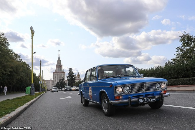 A blue Lada during the rally. The cars were manufactured by AvtoVAZ, a Russian company which is now owned by the French group Renault