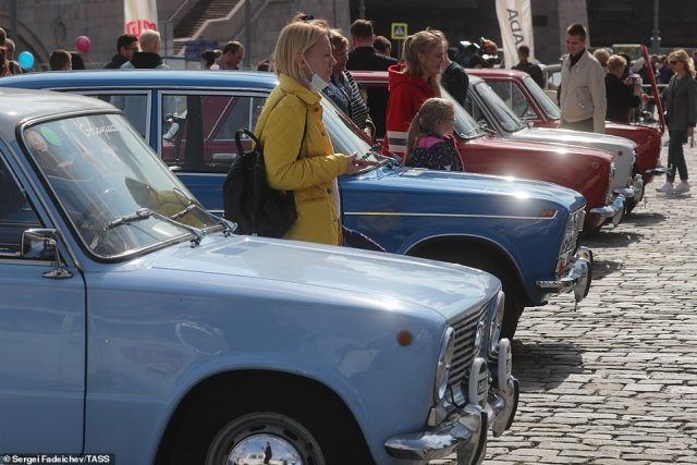 Rows of the vintage cars were parked alongside one another for the rally yesterday, with locals strolling through the area to study the vehicles