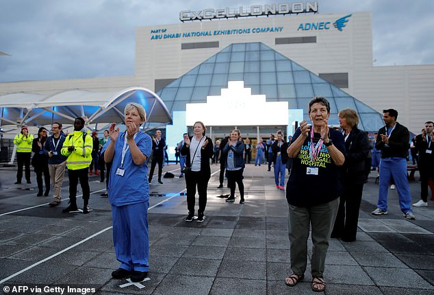 SAGE adviser warned that England could lose control of Covid amid 'worrying' signs among middle-aged people. Pictured: medical staff in the 'clap for carers' outside the ExCel London