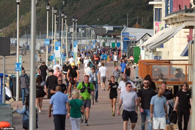 Hundreds of Britons flocked to Bournemouth beach today to enjoy the sunny weather as the UK sees temperatures continue to rise