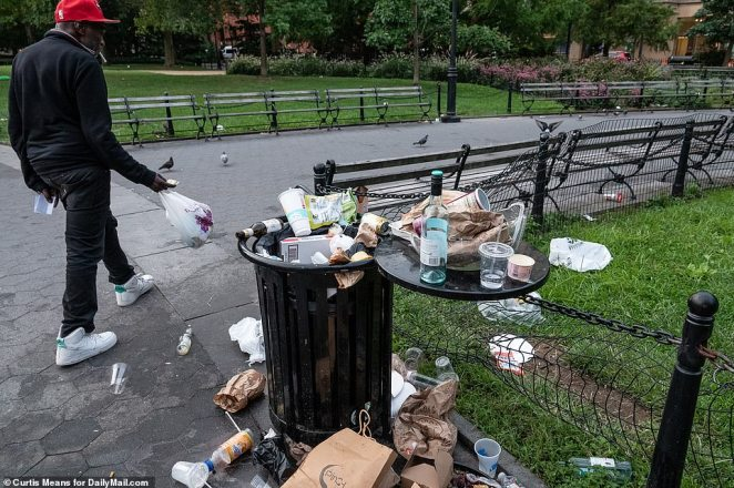 Photos obtained by DailyMail.com showed overflowing garbage cans and discarded alcohol containers strewn over the park