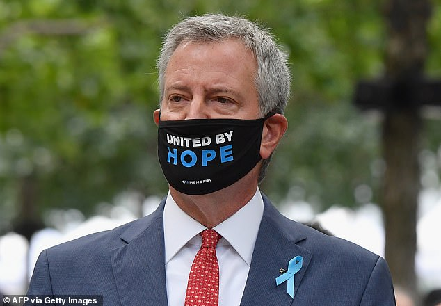 In June, Mayor Bill de Blasio (pictured) announced that part of the NYPD's $6billion budget would be cut and the money redistributed to community initiatives