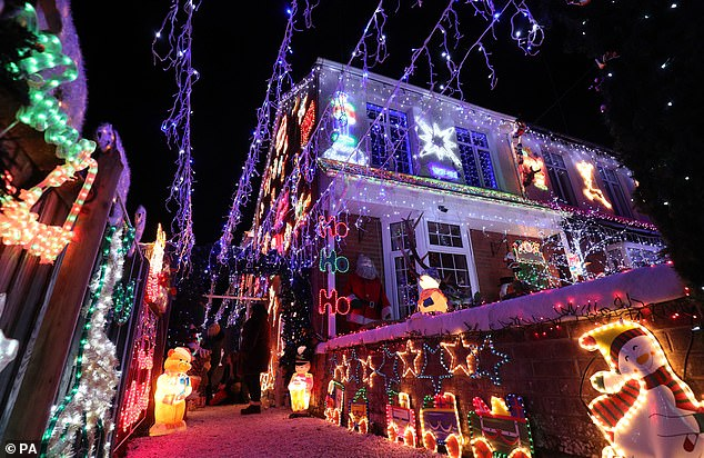 Areas that have already cancelled their events include East Lothian, North and South Lanarkshire, Perth and Kinross, South Ayrshire, Renfrewshire and Highland council areas. (File image of a house in New Milton, Hampshire, covered in Christmas lights on December 4, 2018)