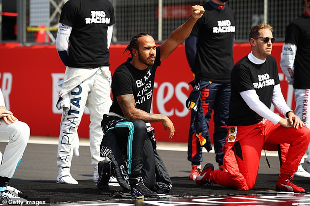Battle: Hamilton has been an instrumental figure in Formula One's support to end racism