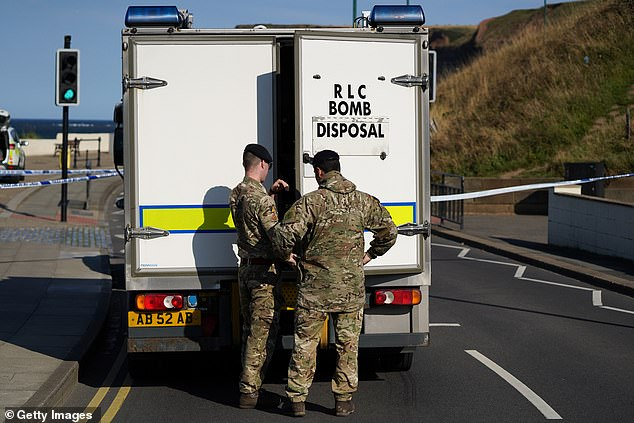 The bomb disposal team are seen arriving at Saltburn beach. The teenage boycalled his family who alerted the authorities and the bomb squad was then sent in