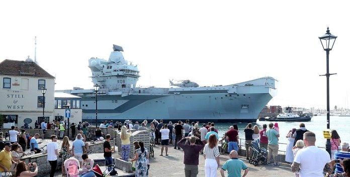 Royal Navy aircraft carrier HMS Queen Elizabeth has returned to Portsmouth from exercises after seven of its crew tested positive for Covid-19