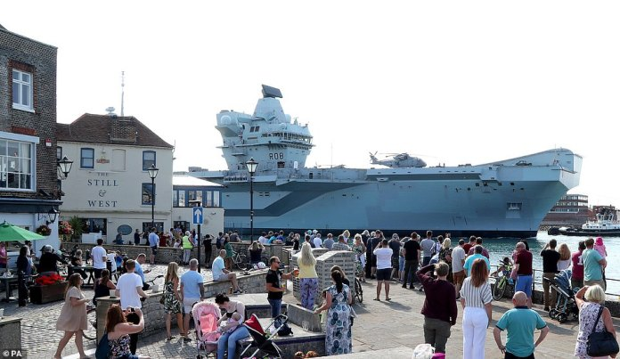 On Sunday, crowds gathered to watch the impressive carrier as it returned to the naval city after it left for exercises