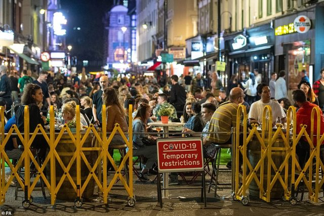 LONDON: General view of people enjoying a night out in Soho, in London's West End tonight, before new lockdown measures are introduced on Monday