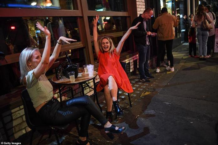 LONDON: Two woman are seen dancing in Soho in London as hundreds headed to the city's famous nightlife district on Saturday night