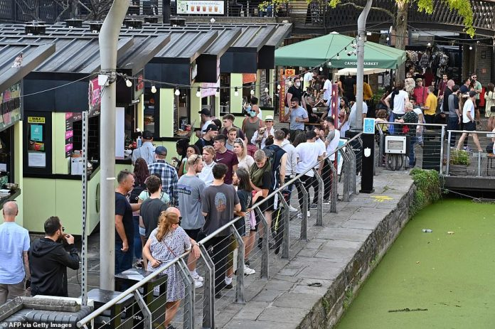In Camden, people were making the most of the good weather before the new restrictions came in as they gathered a food market