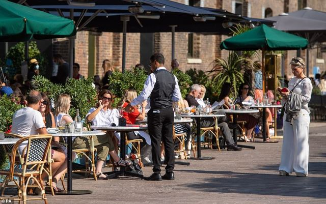 Many were pictured dining out on Sunday as people continue to fill restaurants after the success of Eat Out To Help Out in August