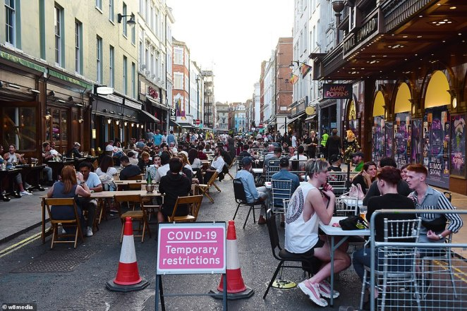In Soho, diners filled the streets as they enjoyed the al fresco seating arrangements in the bustling streets
