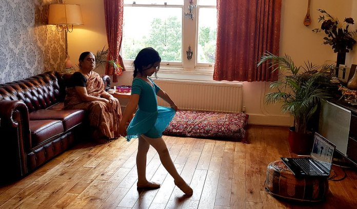 Sister attending online ballet class by Vedant (aged 12 years).A selection of the photographs will be shown in towns and cities across the UK later in the year