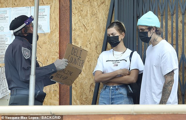 Patient: As they waited for their order, the Vogue cover girl could be seen with her arms folded across her chest, while wearing a black CDC-recommended face mask