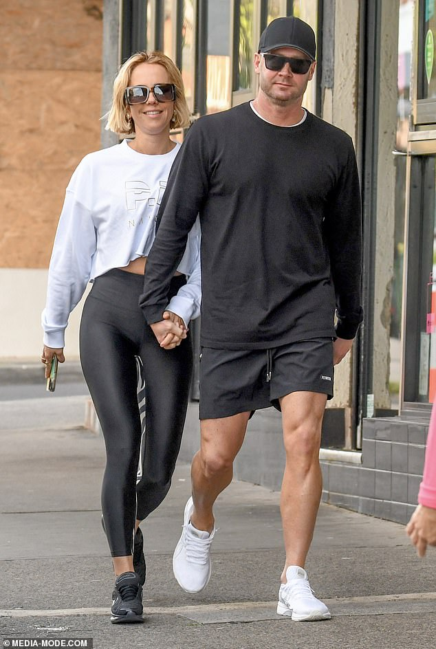 Smitten: Later, the couple held hands as they made their way through the streets of trendy Bondi