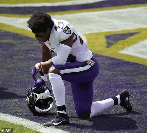 Baltimore Ravens cornerback Marlon Humphrey (44) kneels during a song in honor of Black Lives Matter, before and NFL football game against the Cleveland Browns, Sunday, Sept. 13, 2020, in Baltimore, Maryland
