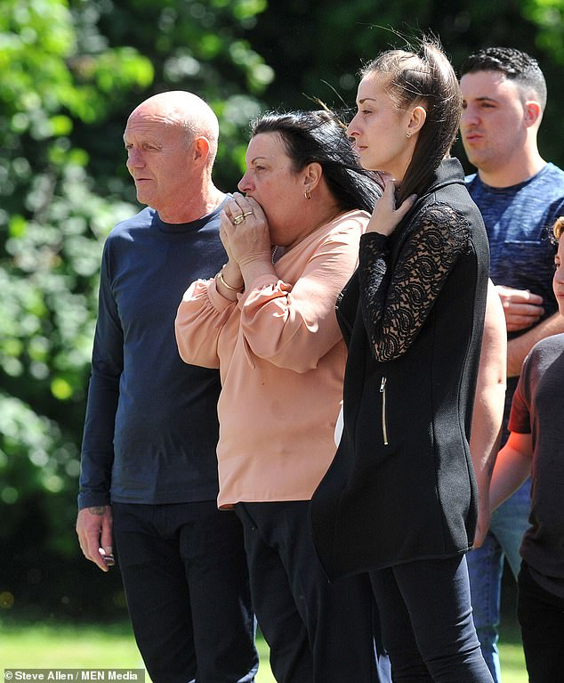 His mother Daryl Price, 55, said it was very difficult to learn that her son was probably the only one of the 22 people who died who could have been saved. Pictured: Ms Price, centre, at her son John's funeral with stepfather Kevan (left) and sister Stacey (right)