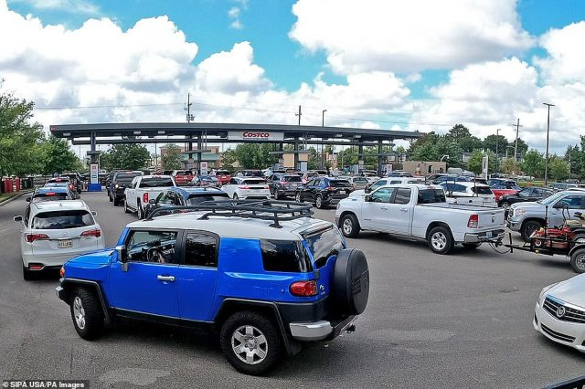 Long lines of cars await gas at the Costco Sunday as New Orleans prepares for the arrival of what is expected to be Hurricane Sally