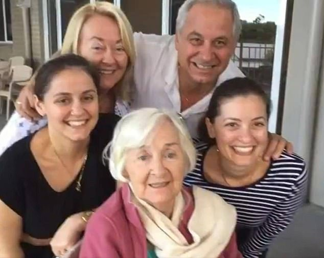 Barbara Zammit (back left) is hoping she will be granted access into Queensland to say goodbye to her dying mother, Angela (centre)