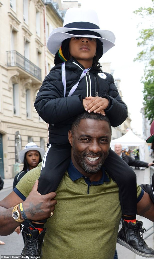 Father figure: Luther Starr is the father of six-year-old son Winston, whom he shares with ex-girlfriend Nayana Garth.  Father and son depicted in Paris in April 2018