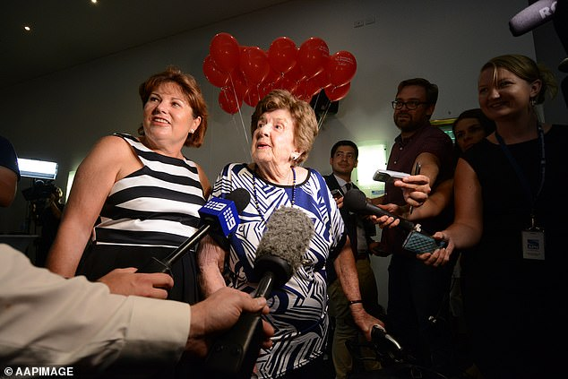 Mrs Erskine (centre) was mobbed by reporters when she arrived at her granddaughter's election victory party in 2015 - and was confident Ms Palaszczuk would winM