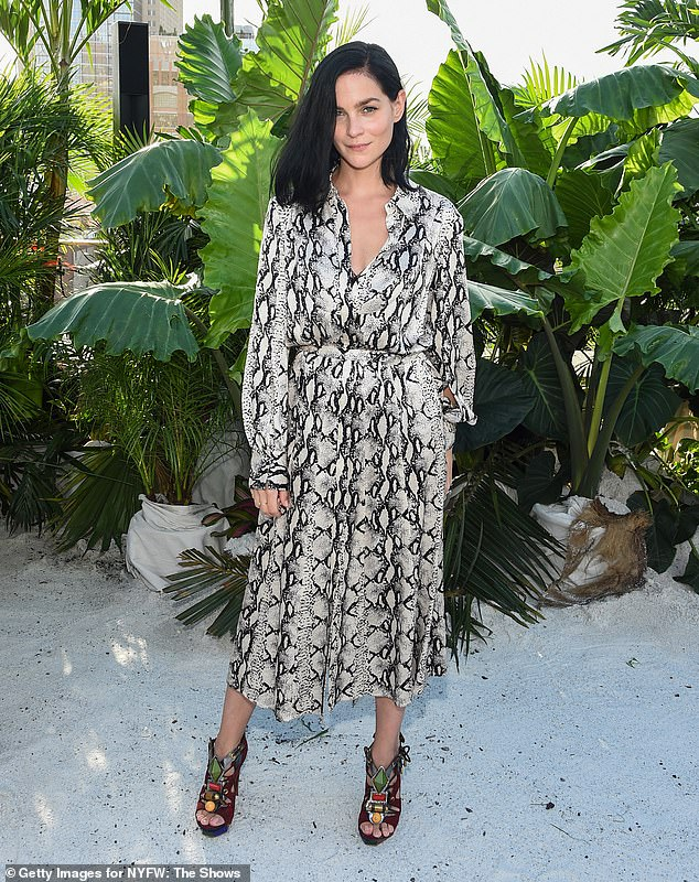 Arrivals:Leigh Lezark radiated natural beauty, while posing among the tropical greenery