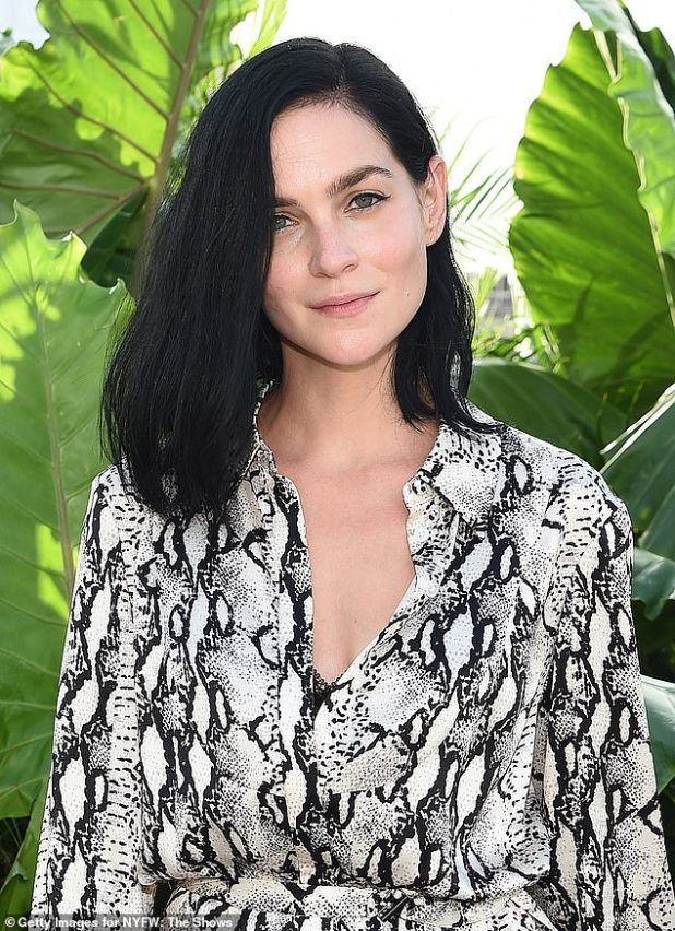 Snakeskin: The 36-year-old model was wearing a tie-wrap snakeskin midi dress, which she opened slightly