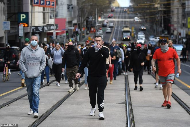 Protesters march through the CBD during an anti-lockdown protest in Melbourne on Sunday, September 13
