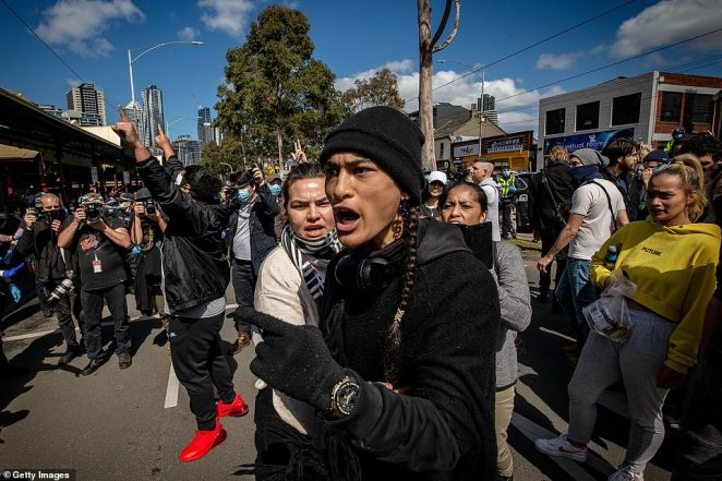 Anti-lockdown protesters organised a 'freedom walk' to demonstrate against Melbourne's current Stage 4 COVID-19 restrictions