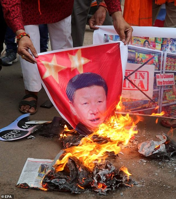 Activists lit a poster of Chinese President Xi Jinping in India in June.  The US Secretary of State said that 'The Quad' could work against China's potential challenge.