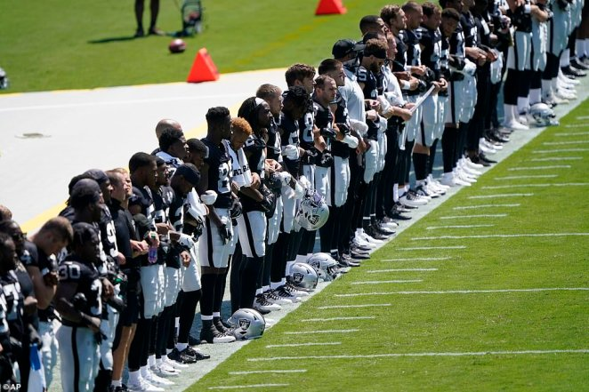 Members of the Las Vegas Raiders stand during the National Anthem before an NFL football game against the Carolina Panthers on Sunday