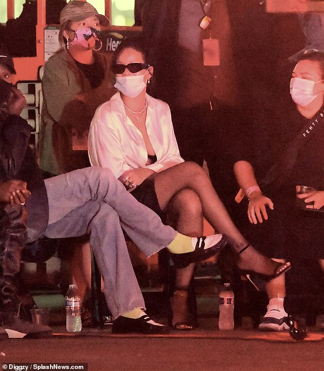 Ouch! Rihanna covered her bruised eye with sunglasses on the set of a secret project in LA on Sunday as she returned to work after having an accident on an electric scooter