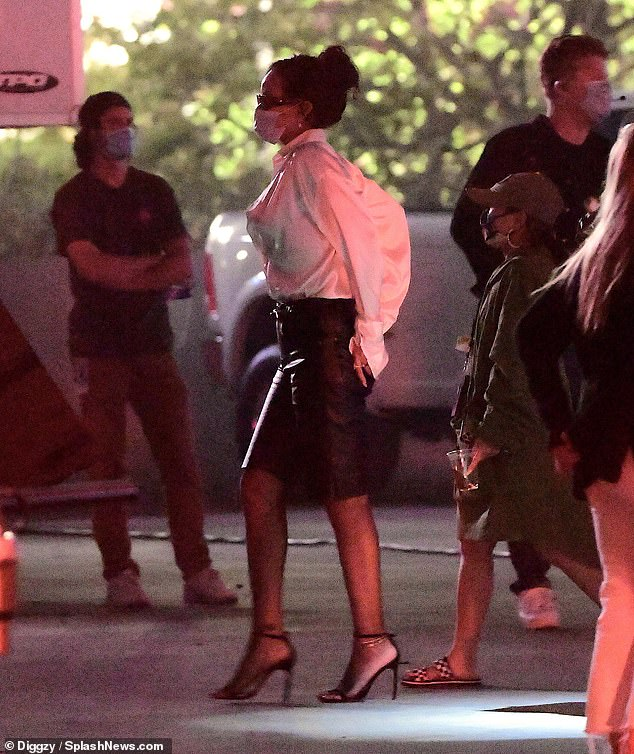 Stylish: Rihanna wore strappy barely there sandals for the outing and had her raven locks fashioned into an up-do