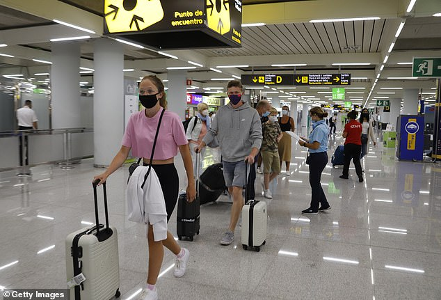 Only 378,000 British tourists visited the country in July ahead of Downing Street's introduction of new quarantine rules on returning holidaymakers, compared to the 2.2 million that put the UK in top spot in July last year. Above, passengers arrive at Palma de Mallorca airport on July 30