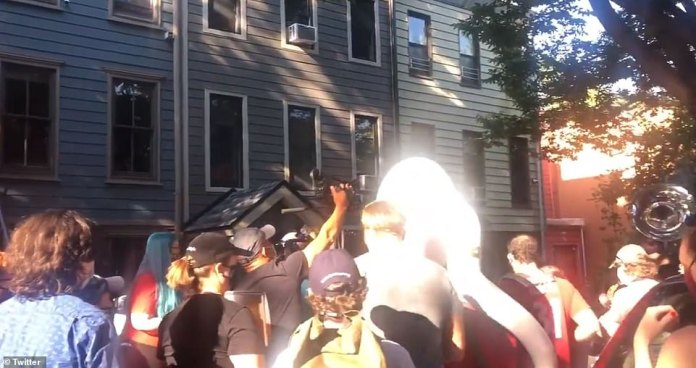 Protesters marched to Gracie Mansion in Manhattan to demand that Mayor Bill de Blasio resigns