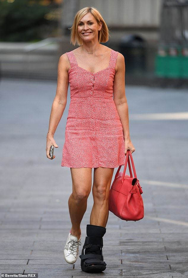 The show must go on: The Scottish broadcaster, 44, wore the healing aid as she walked outside central London's Global Radio studios, staying true to the mantra 'the show must go on'
