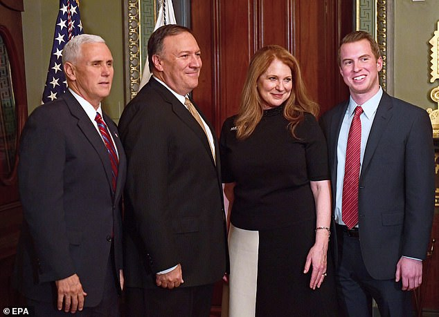 Then-Rep. Pompeo (2-L, Republican of Kansas) poses for a photo with his family prior to being sworn-in as Director of the Central Intelligence Agency (CIA) by US Vice President Mike Pence (L) in the Vice President's ceremonial Office at the White House in Washington, DC, USA, 23 January 2017. Pompeo was accompanied by his wife, Susan (2-R) and his son, Nick (R)