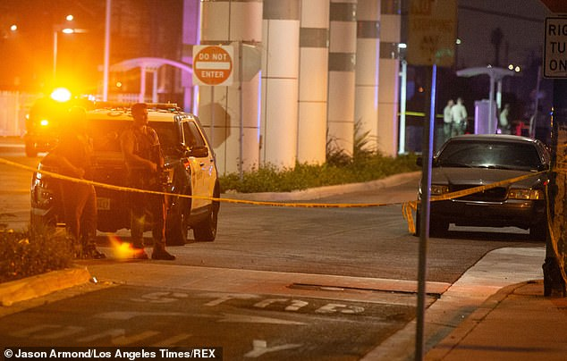 The two officers were shot as they sat in their patrol car shortly before 7pm on Saturday