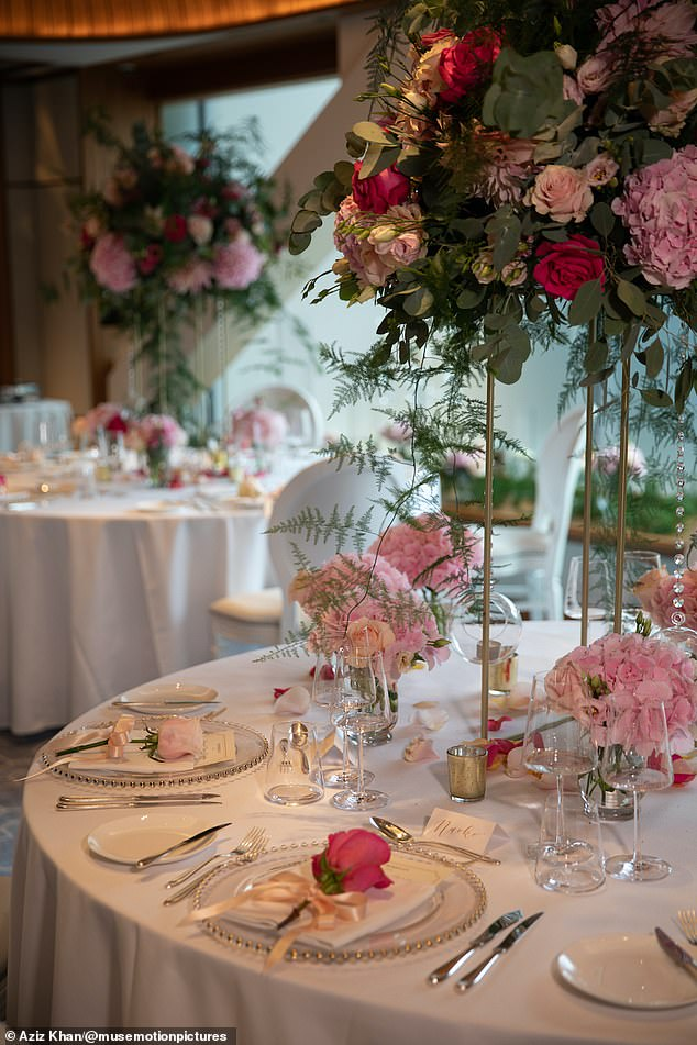 Pretty in pink:The couple celebrated their nuptials with dinner and drinks at five-star The Berkeley hotel in Knightsbridge. Pictured, the stunning table settings at the hotel