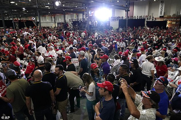 Supporters wait for President Trump to speak at his rally
