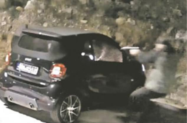 Macris was killed while sitting in his car, which was caught on CCTV
