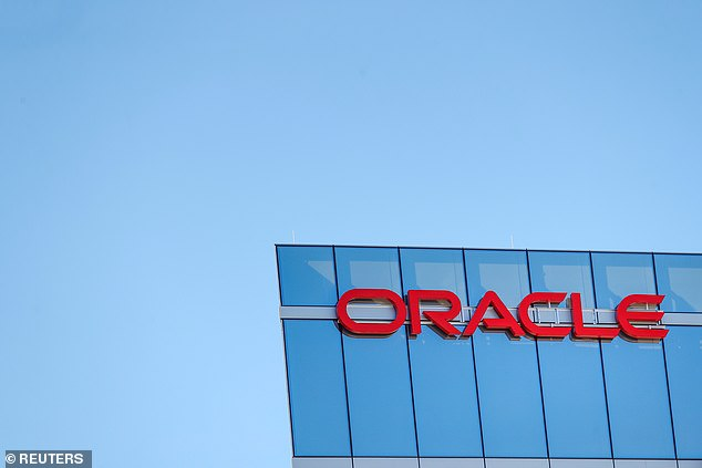 President Donald Trump supporter Larry Ellison co-founded Oracle Corporation in 1977 and it now has 136,000 employees. Pictured: An exterior view of the Oracle Field Office in Arlington, Virginia