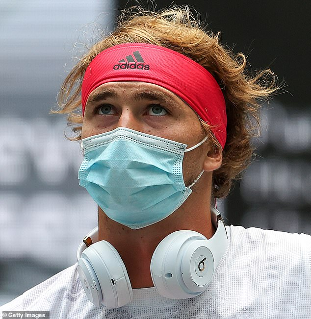 Alexander Zverev of Germany walks on court before his US Open match wearing a face mask
