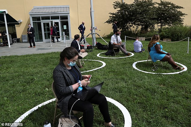 Reporters and guests practice social distancing as Democratic U.S. presidential nominee and former Vice President Joe Biden speaks about climate change during a campaign event at the Delaware Museum of Natural History in Wilmington, Delaware, Thursday