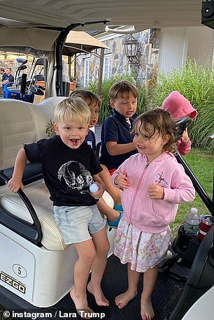 Having a blast: The couple's only son was seen playing in a golf cart with four of his friends