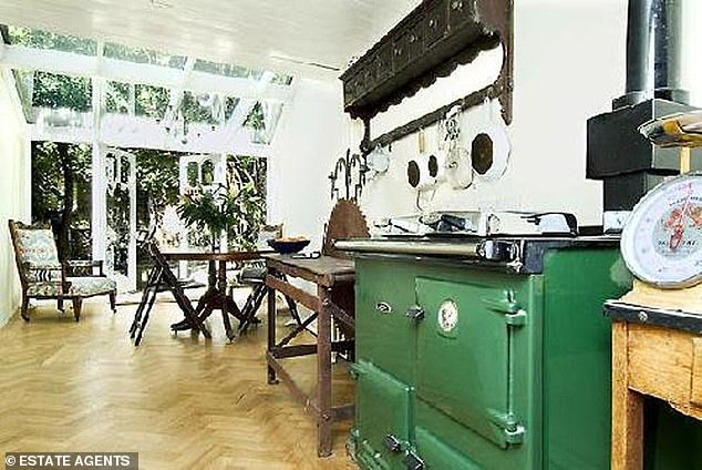 A 24ft long kitchen on the lower ground floor which includes a forest green Aga providing central heating